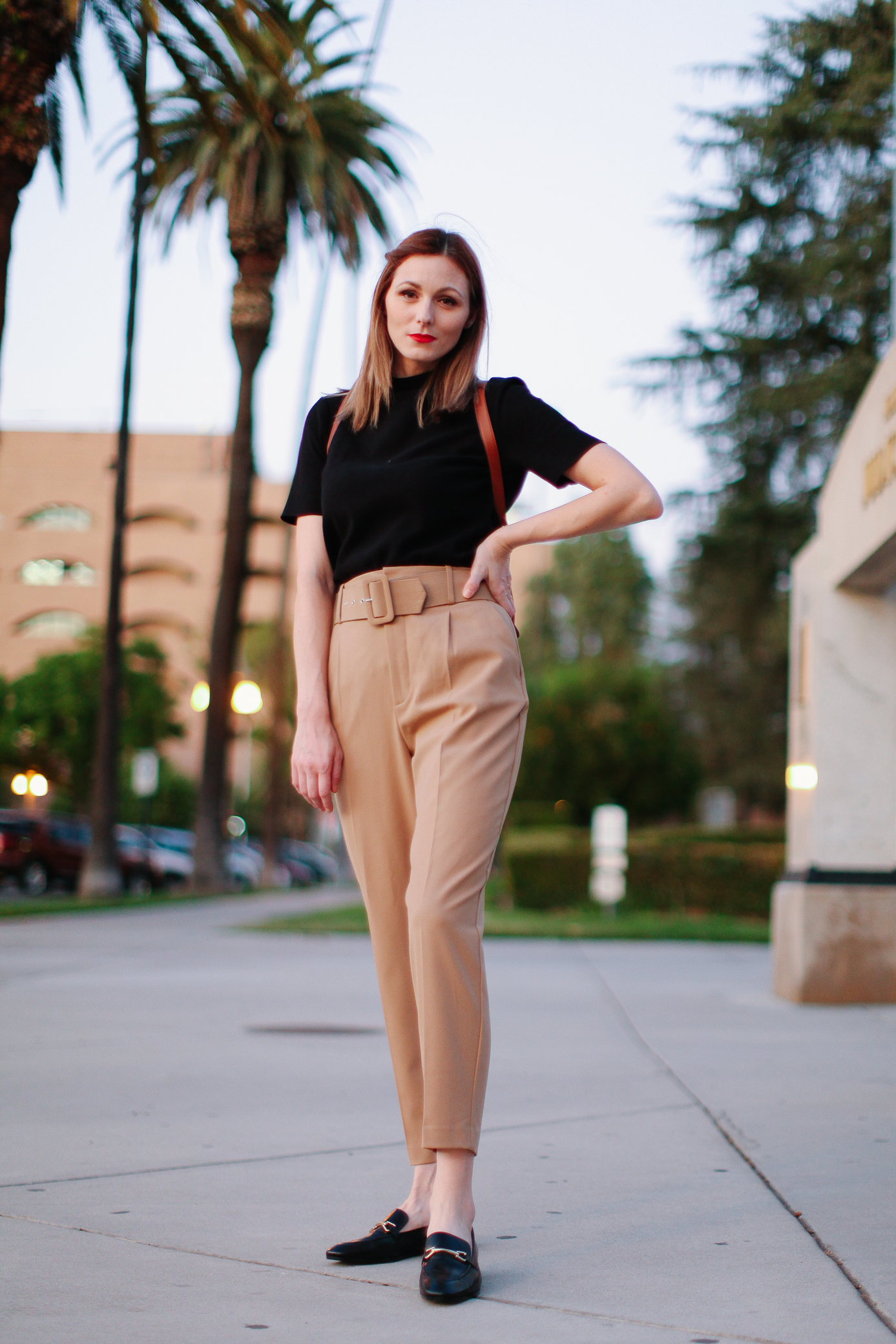 How to style paperbag pants by popular LA fashion blog, Tea Cups and Tulips: image of a woman wearing a black top, beige paperbag pants and black loafers from Zara.