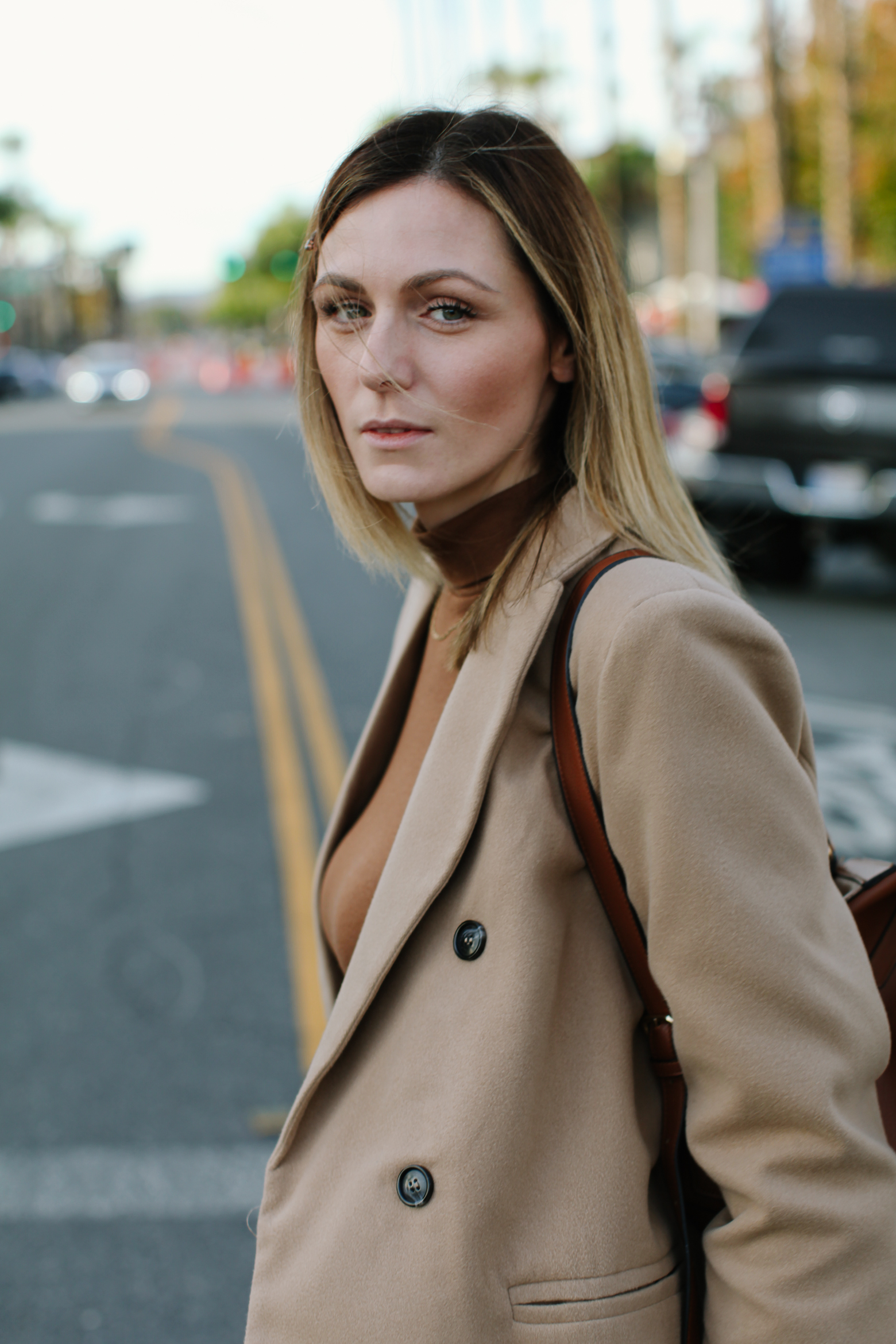 Affordable Camel Coat Picks Under $100 | Affordable Camel Coats by popular Los Angeles fashion blog, Tea Cups and Tulips: image of a woman wearing a SheIn Camel Double Breasted Coat With Welt Pocket, brown Target turtleneck, Diesel jeans, and Mango Zipped detail ankle boots.
